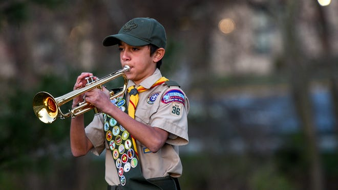 This image has an empty alt attribute; its file name is bugle-playing.jpg